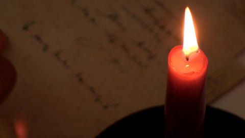 Writing by candlelight 2 Footage