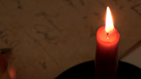 Writing by candlelight 3 Footage