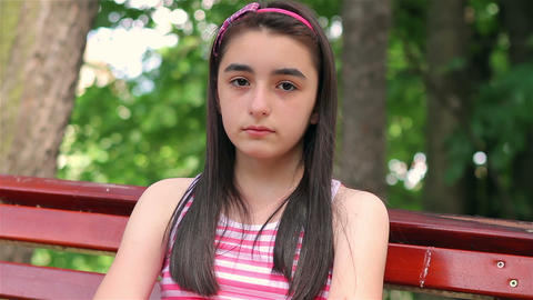 Sad child girl in park Footage