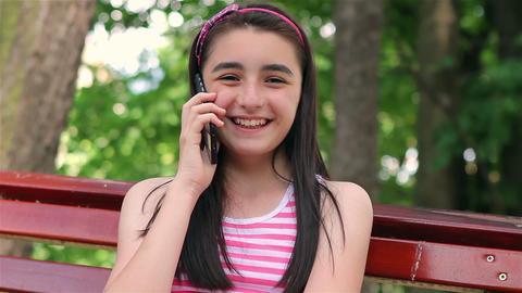 Teenager girl talking on smartphone Footage