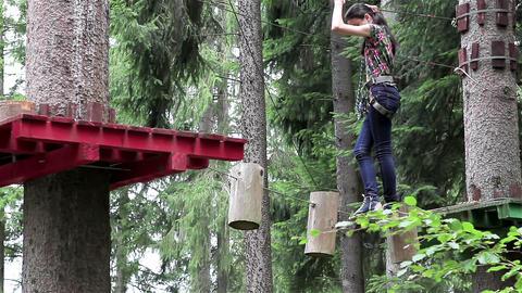Young girl having fun in a climbing adventure Footage