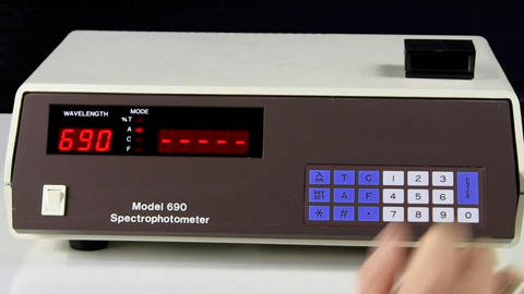 Enter wavelength with keypad into spectrophotometer with alpha chroma key channe Footage