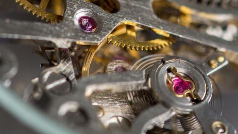 Rack focus macro shot of a clockwork with gearwheels Footage