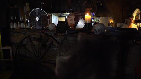 Historic tavern, a restaurant with skulls and bones in Prague. 4K Footage