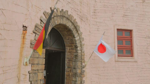 German and Japan flags on cultural village Footage