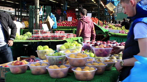 Row of bowls full of fruits in outdoor market 2 Footage