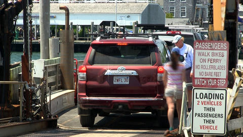 Passengers load onto chappy ferry Footage