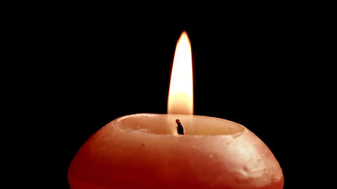 1080p Spinning Candle Close-Up on Black Background Footage
