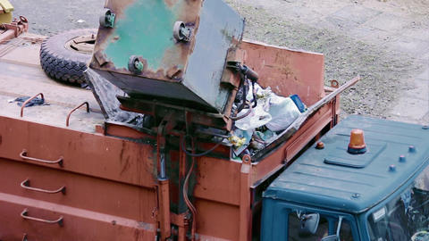 1080p Garbage Truck Sweeps Contents of Waste Container Into Hopper Footage