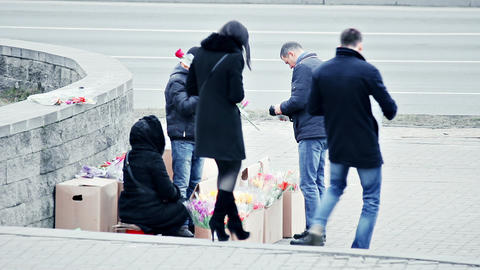 A Stranger Buys Flowers From Street Vendor On International Women's Day stock footage
