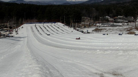 Snow tubing in winter Footage