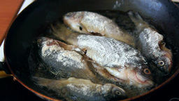 Fish is being fried on the frying pan Footage