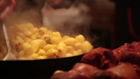 Fragrant Fried Potato And Meat At Street Fair stock footage