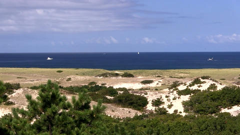 Pan from right to left of race point beach and Atlantic ocean from high vantage  Footage