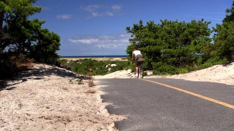 Woman bikes trail Provincetown Cape Cod Footage