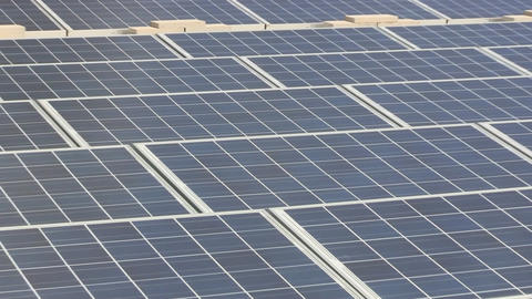 Zoom out of solar panel grid on rooftop of manufacturing facility on Cape Cod Footage