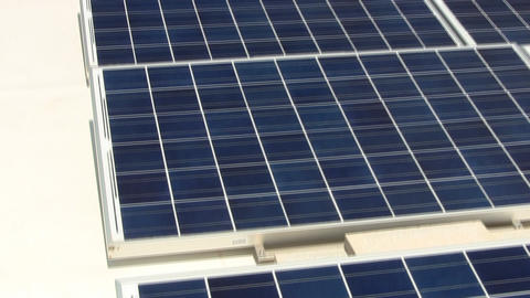 Tilt of solar panels on rooftop providing clean energy to Cape Cod electronics m Footage