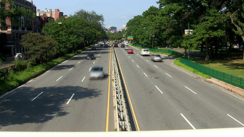 Time-lapse of storrow drive along Charles river in Boston from footbridge overpa Footage