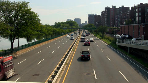 Storrow drive in Boston along Charles river from footbridge overpass on hot summ Footage