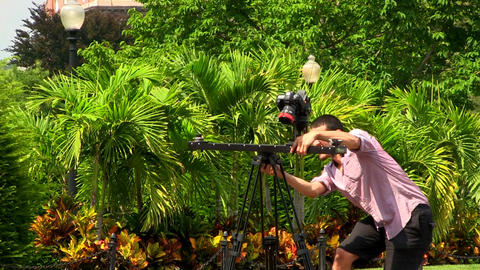 A stock photographer positions his new camera and gear to take stock footage of  Footage