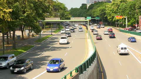 Traffic along storrow drive in Boston on summer day Footage