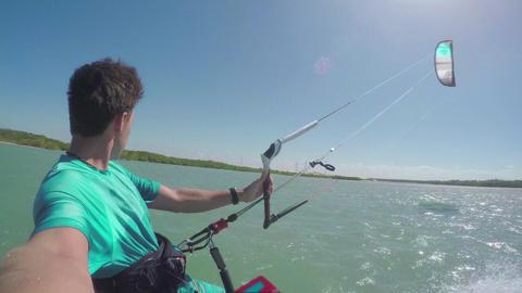 Kiter kiteboarding in sunny flat lagoon Footage