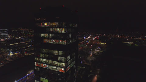 AERIAL: Flying around the skyscraper at night Footage