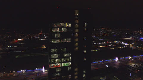 AERIAL: Glass office building at night Footage