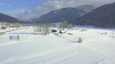 AERIAL: Flying over sunny mountain valley Footage