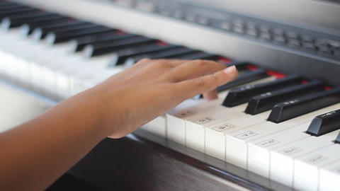 A child's hand playing the piano Footage