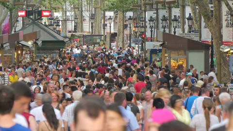 Crowded Les Rambles Boulevard in Barcelona Zoomed Live Action