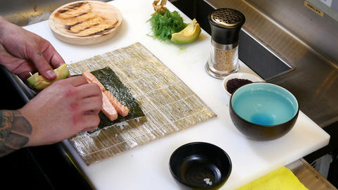 Sushi Chef Preparing Salmon Uramaki Roll stock footage