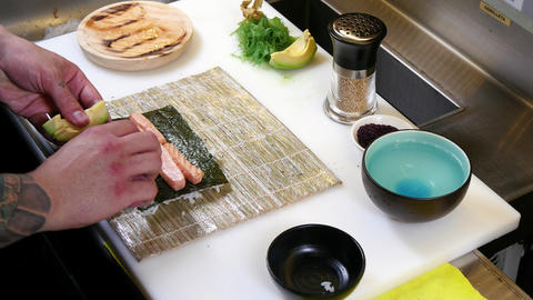 Sushi Chef Preparing Salmon Uramaki Roll 4k stock footage
