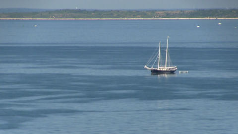 Sailboat makes its way across vineyard sound on calm summer day. View of Elizabe Footage