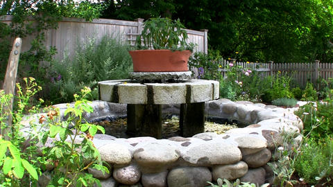 A water fountain in herb garden at Heritage Museums and gardens on Cape Cod Footage
