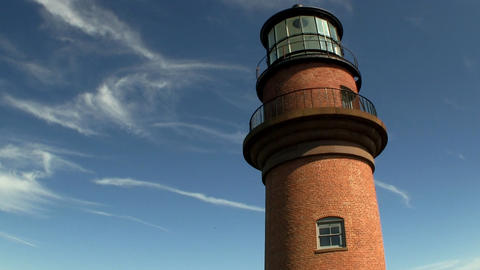 Lighthouse at Gay Head Aquinnah on Martha's Vineyard against bright blue sky and Footage
