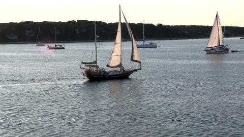 View from deck of ferry boat as it passes sailboats leaving Vineyard Haven on Ma Footage