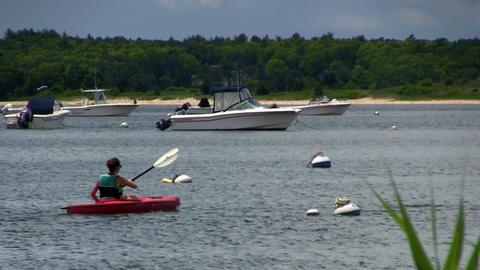 Girls paddle kayaks Footage
