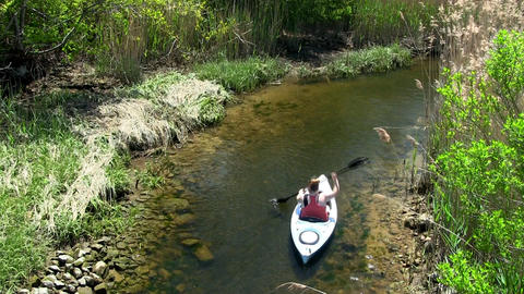Upstream female kayaker Scorton Creek Sandwich Cape Cod Footage