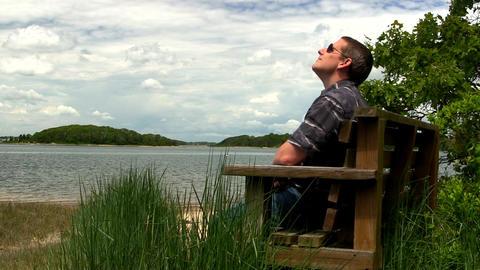 Man on beach bench; 3 Cape Cod Footage