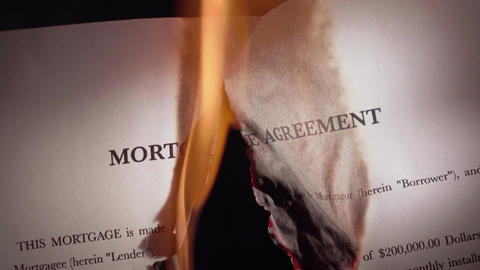 2 Closeup Of Mortgage Agreement Burning On Fire Footage