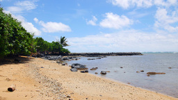 Molokai beach lined with boulders in Hawaii Footage