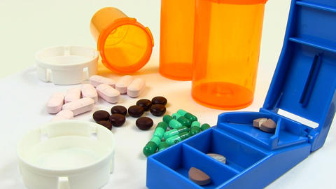 Drugs And Medicine; Capsules, Pills, Tablets And Splitter Rotate Clockwise; 2 stock footage