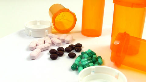 Drugs and Medicine; capsules, pills and tablets rotate clockwise; 2 Footage