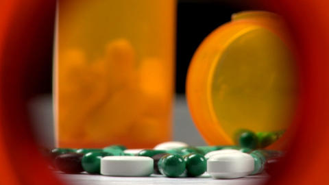 Drugs And Medicine; Capsules, Pills And Tablets From Inside Bottle; 5 stock footage