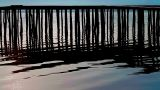 Rippling lake and wooden jetty Footage