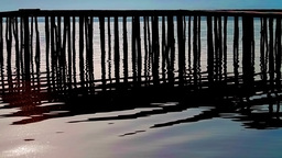Rippling lake and wooden jetty Stock Video Footage