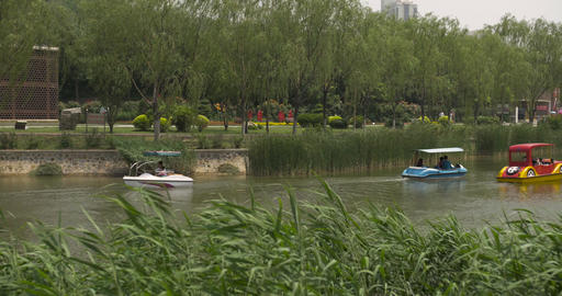 4K People Ride Paddle Boats on a Park Lake in China - 2 Shot Combo Footage