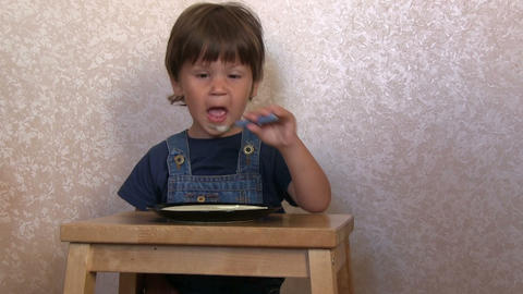 Boy Eating Porridge stock footage