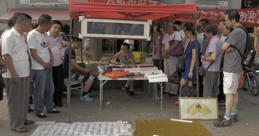 4K Calligrapher Writes Chinese Characters Crowd Watches, Live Action